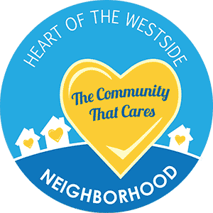 two tone blue sign with yellow heart reading heart of the westside