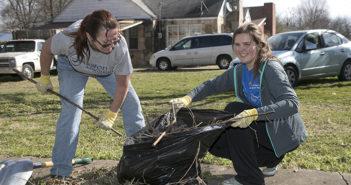 Two women doing yard work